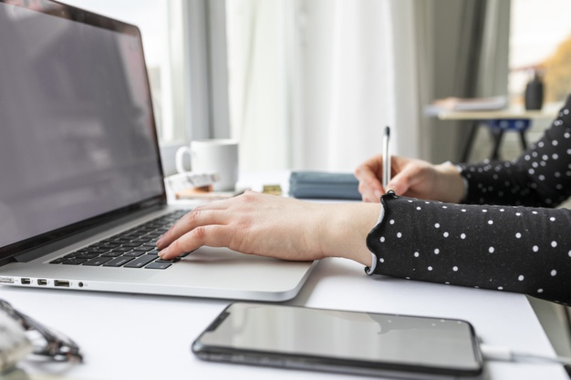 side-view-businesswoman-working-laptop_23-2148488614
